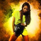 Sexy woman with safety jacket and helmet Royalty Free Stock Images