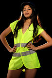 Sexy woman with safety jacket and helmet Royalty Free Stock Image