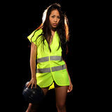 Sexy woman with safety jacket or vest and helmet Royalty Free Stock Images