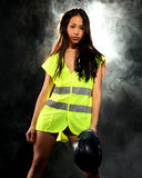 Sexy woman with safety jacket or vest and helmet Royalty Free Stock Photos