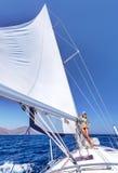 Sexy woman on sailboat Stock Photo