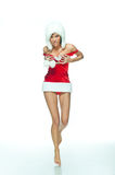 Sexy woman Santa. Sexy woman in skimpy Santa Clause outfit and winter hat.  White background Royalty Free Stock Images