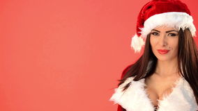 Sexy Woman in Santa Claus Costume Looking Her Right Over Red stock video
