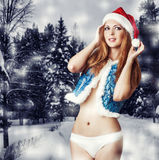 Sexy woman santa claus in white pants Royalty Free Stock Image