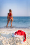 woman in santa hat on sea Stock Images