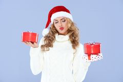 Sexy woman in Santa hat trying to decide Royalty Free Stock Photos