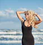 Sexy woman on the sea shore Royalty Free Stock Photos