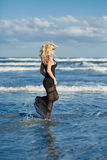 Sexy woman on the sea shore Royalty Free Stock Images