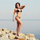Sexy woman at seaside. Fitness lady. Royalty Free Stock Photos