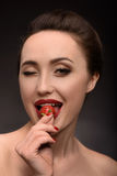Sexy woman seducing with sweet berry Royalty Free Stock Images