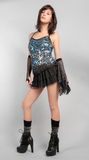 Sexy Woman in Sequin Top and Mini Skirt. An image of an attractive young woman in a sexy, fun party outfit Stock Photo