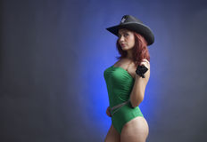 Sexy woman in sheriffs hat Royalty Free Stock Image