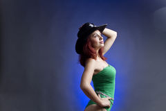 Woman in sheriffs hat. Side portrait of young woman in bikini with sheriffs hat, studio background stock photo