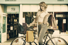 woman with shopping bags in vintage color royalty free stock photos