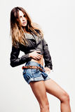 sexy woman in shorts and leather jacket Royalty Free Stock Photos