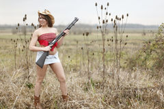 Sexy woman with shotgun Royalty Free Stock Images