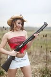 Sexy woman with shotgun Stock Photo