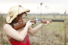 Sexy woman with shotgun Stock Photos