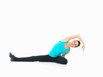 woman showing fitness moves, white background Royalty Free Stock Photo