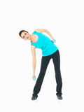Sexy woman showing fitness moves, white background Royalty Free Stock Photos