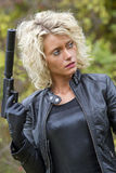 Woman with silencer gun stock photo