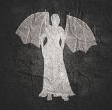 Woman silhouette in dress. Woman silhouette with bone wings standing in evening dress stock image