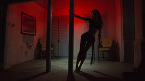 Sexy Woman Silhouette Dancing at the Hotel. Pole Dancer female S. Tripper in the Night brothel. Sensual Red light, noir style. Beautiful Dancing Girl with Sexy Royalty Free Stock Photos