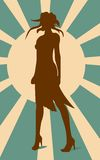 Sexy woman silhouette in short dress. Sun rays backdrop Stock Photography