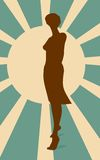 Sexy woman silhouette in short dress. Sun rays backdrop Royalty Free Stock Images