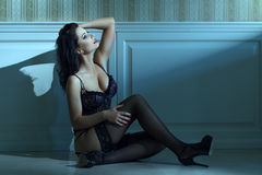 Sexy woman sit on the floor at night Royalty Free Stock Image