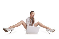 Sexy woman sit with notebook and long legs Royalty Free Stock Photo