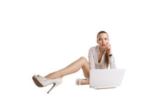 Sexy woman sit with notebook and long legs Royalty Free Stock Images
