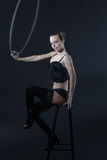 Sexy woman sit on stool with aerial hoop Royalty Free Stock Photos