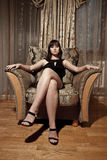 Sexy woman sitting in armchair Royalty Free Stock Photos