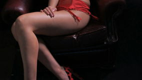 woman sitting on armchair wearing lingerie