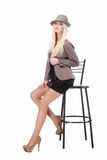 Sexy woman sitting on bar chair Stock Photo