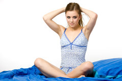 Sexy woman sitting in the bed Royalty Free Stock Photos