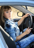 Sexy woman sitting in the car Stock Photos