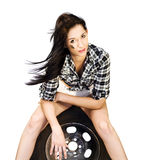 Sexy Woman Sitting On Car Tyre Stock Images