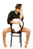 Sexy woman sitting on a chair Stock Photos