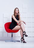 Sexy woman sitting on a chair. Fashion shot Royalty Free Stock Photography