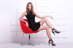 Sexy woman sitting on a chair. Fashion shot Royalty Free Stock Images