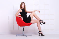Sexy woman sitting on a chair. Fashion shot Stock Images