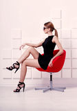 Sexy woman sitting on a chair. Fashion shot Stock Image