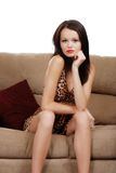 Sexy woman sitting on a couch Stock Photography