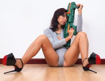 Never without her toy gun Stock Image