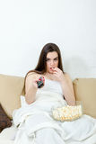Sexy woman is sitting home alone on saturday night Royalty Free Stock Photo