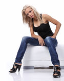 Sexy woman sitting on sofa Stock Photo
