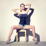 Sexy woman sitting on stool Stock Image