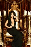 Sexy woman sitting on throne Royalty Free Stock Images